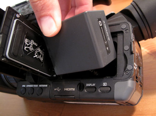 Inserting battery into Sony NX70